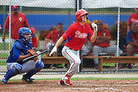 Philadelphia Phillies Mark Laird (24) at bat in front of catcher Matt Morgan (21) during an instructional league game against the Toronto Blue Jays on September 28, 2015 at Englebert Complex in Dunedin, Florida.  (Mike Janes/Four Seam Images)