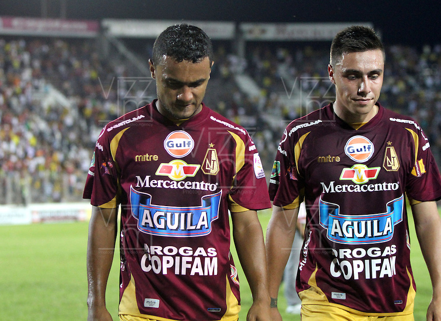 IBAGUÉ -COLOMBIA, 7-07-2013. Tristeza de los  Jugadores del Deportes Tolima al perder su clasificación a la final del torneo Liga Postobón  con el  Itagüi ,  durante partido de los cuadrangulares finales, fecha 6, de la Liga Postobón 2013-1 jugado en el estadio Manuel Murillo Toro la ciudad de Ibagué./  Top of Form 1<br /> Lowering the Players of Deportes Tolima to lose their qualification to the final tournament with Itagüi Postobón League during the quadrangular final match, dated 6, the League played in 2013-1 Postobón Manuel Murillo Toro stadium in Ibague <br /> . Photo: VizzorImage/ Felipe Caicedo/ STAFF