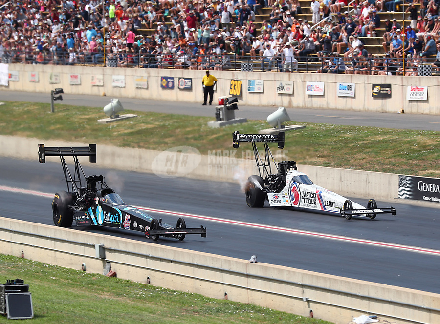 Jul 22, 2018; Morrison, CO, USA; NHRA top fuel driver Scott Palmer (left) alongside Antron Brown during the Mile High Nationals at Bandimere Speedway. Mandatory Credit: Mark J. Rebilas-USA TODAY Sports