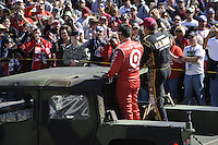 Juan Pablo Montoya (#42) and Ryan Newman (#39) wave to fans during driver intros.