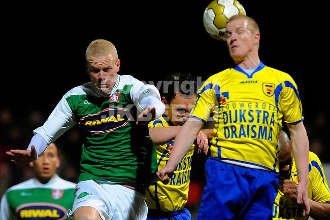 LEEUWARDEN - Voetbal, SC Cambuur - FC Dordrecht, Cambuur stadion, seizoen 2011-2012, 05-03-2012  FC Dordrecht speler  Tom Beugelsdijk (l) in duel met SC Cambuur speler Martijn van der Laan.