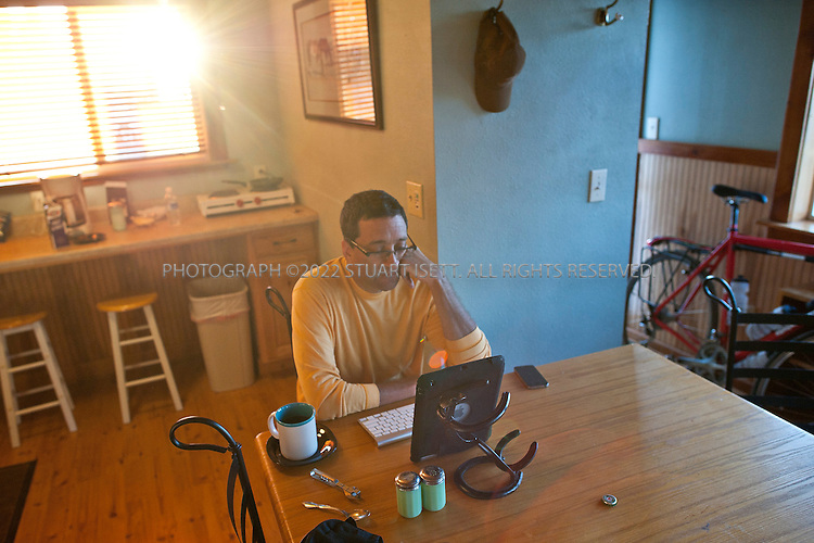 8/4/2011--Dusty, WA, USA..Bruce Weber checks his email at the Alkali Ranch Creek bunk house. Using an iPad and bluetooth key board means Weber travels with less weight than a regular laptop on his cross country bike ride. On this day Weber was continuing his ride, hoping to get to Cheney, WASH., 65 miles away...New York Times reporter Bruce Weber in Eastern Washington state as he continues his cross country ride that started in Astoria, OR. ..©2011 Stuart Isett. All rights reserved.