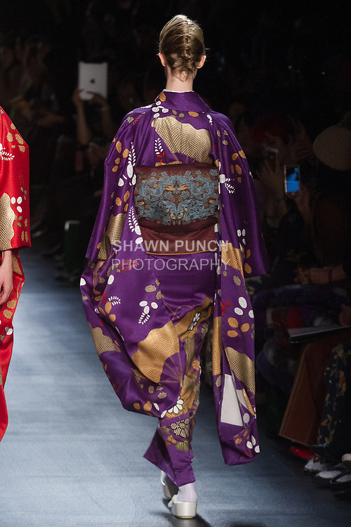 "Model walks runway in a ""Negative"" silk kimono from the Hiromi Asai Fall Winter 2016 ""Spirit of the Earth"" collection by Hiromi Asai & Kimono Artisan Kyoto, presented at NYFW: The Shows Fall 2016, during New York Fashion Week Fall 2016."
