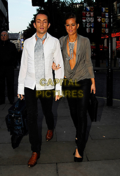 KATE LAWLER & GUEST.Attends The Perfume Shop / LK High Street Fashion Awards, Cafe De Paris, 3 Coventry Street, London, England..May 14th 2007.full length grey gray top plunging neckline low cut necklace cleavage black skinny jeans zip cowel neck arms linked scarf bag white shirt eyes closed.CAP/IA.©Ian Allis/Capital Pictures