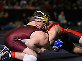 Andrew Lenzi (C) and Brian Benton (II) square off in the NY State Division One finals at the 130 weight class during the NY State Wrestling Championship finals at Blue Cross Arena on March 9, 2009 in Rochester, New York.  (Copyright Mike Janes Photography)