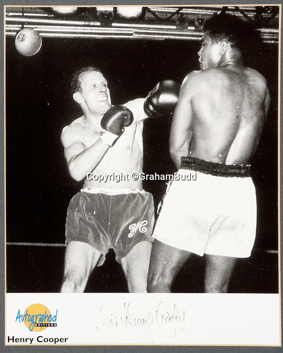 BNPS.co.uk (01202 558833)<br /> Pic: GrahamBudd/BNPS<br /> <br /> Cooper delivers his knockout blow...<br /> <br /> For sale...'Enry's 'Ammer's that floored The Greatest.<br /> <br /> A British boxing legend's gloves - that Muhammad Ali claimed hit him so hard &quot;his ancestors in Africa felt it&quot; have emerged for auction for the knock out price of &pound;50,000. <br /> <br /> Sir Henry Cooper wore them when he sent him crashing to the mat with his trademark 'Enry's 'Ammer' left hook in front of a baying Wembley crowd in 1963.<br /> <br /> Described at the time as 'the punch that shook the world' it was one of the few times the fighter was floored - although he controversially recovered.