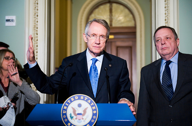 Senate Majority Leader Harry Reid, D-Nev., holds up his hand as reporters barrage him with questions during a news conference with Sen. Richard Durbin, D-Ill., following their meeting with Illinois Senator designate Roland Burris on Jan. 7, 2009.
