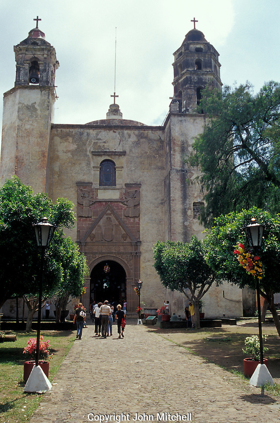 Entrance to the church at the Ex-Convento Dominico de la Natavidad in Tepotzlan, Morelos, Mexico. This Dominican monastery was built between 1560 qnd 1588. Its church has a Plateresque facade. The monastery now houses a regional history museum. This convent is a UNESCO World Heritage Site.