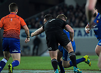 NZ's Sam Cane tackles France's Remi Grosso during the Steinlager Series international rugby match between the New Zealand All Blacks and France at Eden Park in Auckland, New Zealand on Saturday, 9 June 2018. Photo: Dave Lintott / lintottphoto.co.nz