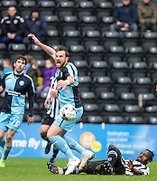 Stanley Aborah of Notts County tackles Paul Hayes of Wycombe Wanderers during the Sky Bet League 2 match between Notts County and Wycombe Wanderers at Meadow Lane, Nottingham, England on 28 March 2016. Photo by Andy Rowland.