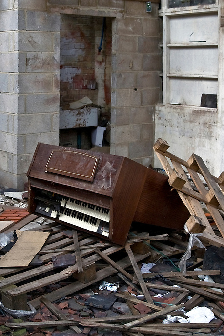 A destroyed organ lies amidst rubble in the ruins of the George Wooliscroft and Sons tile factory in Stoke-on-Trent. In operation since 1894, the factory closed in 2000 and has since remained derelict. The demise of once world-renowned industries in the region has left a scarred landscape and relatively high levels of unemployment throughout Staffordshire.