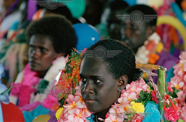 Colourfully adorned graduates of Uniting Church of the Solomon Islands during their graduation ceremony at Seghe seminary near Marovo Lagoon.
