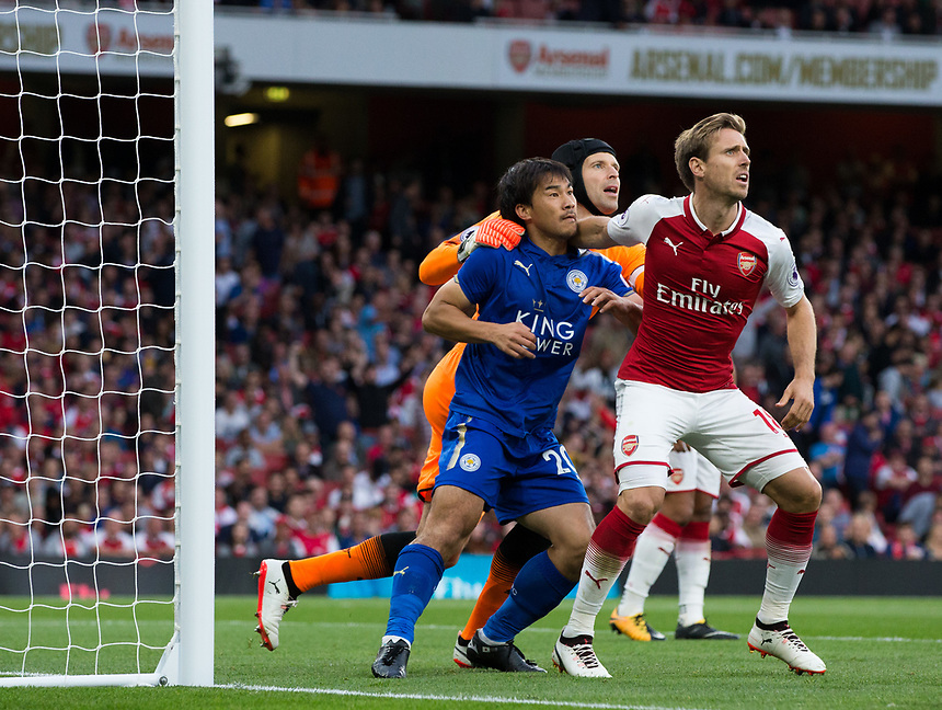 Leicester City's Shinji Okazaki is heavily marked at a corner by Arsenal's Petr Cech and Nacho Monreal<br /> <br /> Photographer Craig Mercer/CameraSport<br /> <br /> The Premier League - Arsenal v Leicester City - Friday 11th August 2017 - Emirates Stadium - London<br /> <br /> World Copyright &copy; 2017 CameraSport. All rights reserved. 43 Linden Ave. Countesthorpe. Leicester. England. LE8 5PG - Tel: +44 (0) 116 277 4147 - admin@camerasport.com - www.camerasport.com