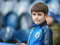 A young Huddersfield Town fan awaits kick-off<br /> <br /> Photographer Alex Dodd/CameraSport<br /> <br /> The Premier League - Huddersfield Town v Swansea City - Saturday 10th March 2018 - John Smith's Stadium - Huddersfield<br /> <br /> World Copyright &copy; 2018 CameraSport. All rights reserved. 43 Linden Ave. Countesthorpe. Leicester. England. LE8 5PG - Tel: +44 (0) 116 277 4147 - admin@camerasport.com - www.camerasport.com