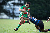 Tevita Halafihi breaks out of Trina Nahi's tackle. Counties Manukau Premier Club Rugby game between Onewhero and Waiuku, played at Onewhero on Saturday May 26th 2018. Onewhero won the game 24 - 20 after leading 17 - 12 at halftime. <br /> Onewhero Silver Fern Marquees 24 -Vaughan Holdt, Filipe Pau, Sean Bagshaw tries, Rhain Strang 3 conversions, Rhain Strang penalty.<br /> Waiuku Brian James Contracting 20 - Christian Walker, Fuifatu Asomua, Aaron Yuill tries, Christian Walker conversion, Christian Walker penalty .<br /> Photo by Richard Spranger.