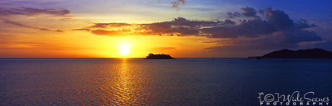Sunset over Wadigi Island in the Mamanucas, Fiji Islands<br /> <br /> Image taken on large format panoramic 6cm x 17cm transparency. Available for licencing and printing. email us at contact@widescenes.com for pricing.
