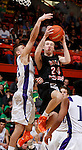 RAPID CITY, S.D. MARCH 20, 2015 -- Ty Hoglund #24 of Dell Rapids goes for a layup past Nathan Galbraith #22 of Winner during their semi-final game at the 2015 South Dakota State A Boys Basketball Tournament at the Don Barnett Arena in Rapid City, S.D.  (Photo by Dick Carlson/Inertia)