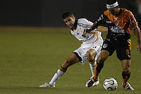 LA Galaxy (18) Kyle Martino and CF Pachuca (8) Gabriel Caballero battle for the ball. The LA Galaxy of MLS defeated CF Pachuca of the Mexican First Division 2-1 during an opening round SuperLiga match at the Home Depot Center, Carson, CA, on July 24, 2007.
