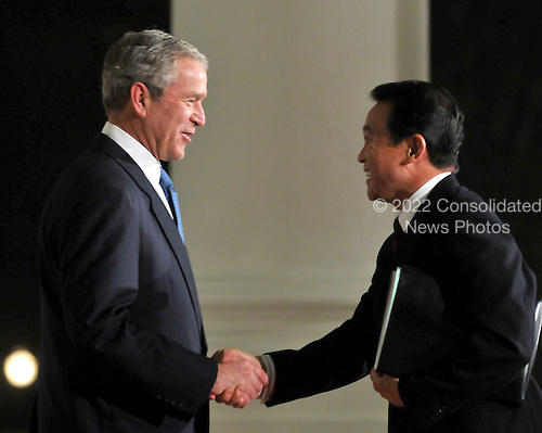 Washington, D.C. - November 14, 2008 -- United States President George W. Bush welcomes Prime Minister Taro Aso of Japan to the Summit on Financial Markets and the World Economy on the North Portico of the White House in Washington, D.C. on Friday, November 14, 2008..Credit: Ron Sachs / Pool via CNP