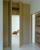 In an intelligent piece of design a pair of doors which form part of a wall of cupboards open up to reveal a bedroom