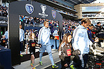07 December 2013: Kansas City's Chance Myers (left) and Seth Sinovic (right) march onto the field before the game. MLS Cup 2013 was played between Sporting Kansas City and Real Salt Lake at Sporting Park in Kansas City, Kansas. Sporting Kansas City won the championship by winning the penalty kick shootout 7-6 after the game ended in a 1-1 tie.