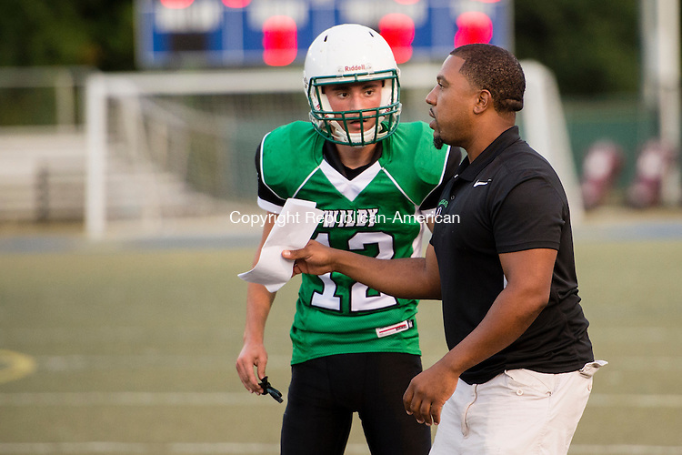 WATERBURY, CT - 25 September 2015-092515EC11-- Wilby's coach Lamarr Kennedy talks to Fatmir Kaliki in a game against Kennedy Friday night at Municipal Stadium. Erin Covey Republican-American.