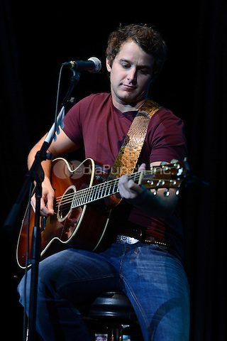 HOLLYWOOD FL - OCTOBER 21 : Easton Corbin performs at Hard Rock live during the 99.9 KISS Country Stars N Guitars concert held at the Seminole Hard Rock hotel & Casino on October 21, 2012 in Hollywood, Florida.  Credit: mpi04/MediaPunch Inc.