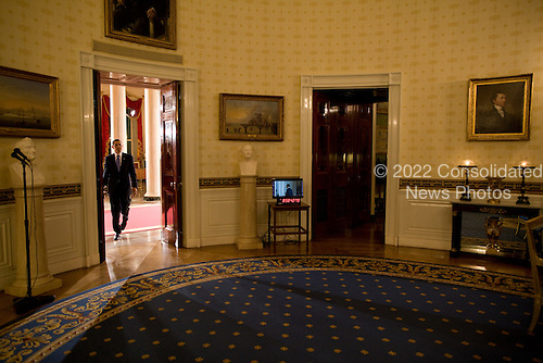 Washington, DC - April 29, 2009 -- United States President Barack Obama returns to the Blue Room after a prime time press conference in the East Room of the White House, Wednesday, April 29, 2009. .Mandatory Credit: Pete Souza - White House via CNP