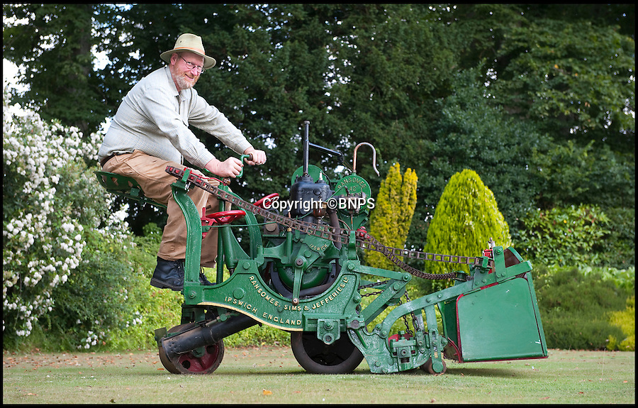 BNPS.co.uk (01202 558833)<br /> Pic: PhilYeomans/BNPS.co.uk<br /> <br /> Lawnmowing history...<br /> <br /> One man went to mow.<br /> <br /> The worlds first powered mower has taken to the grass once more after an exhaustive restoration by lawnmower nut Andrew Hall from Somerset.<br /> <br /> Forerunner of all the machines that have graced British lawns on sunday afternoons through the decades since, This 1902 Ransome 3hp is a historic survivor from the Edwardian age when chauffers were given the task of grooming their masters lawns and the new fangled machines cost as much as a house.<br /> <br /> The 1 1/4 ton leviathan cost £137 in 1903 - equivalent to a whopping £15,000 in todays money. In consequence they were only available to the very rich, but aristocratic one upmanship lead to a rapid 'lawnmower arms race' untill the first war intervened.<br /> <br /> Although the first machine it still boasts many of the features still common a century later, 42inch blade, heavy roller, tiller steering, a huge grass box that could be emptied from the driver seat and adjustable blade height. Brakes however were a later innovation so much skill was required to pilot the huge contraptions.