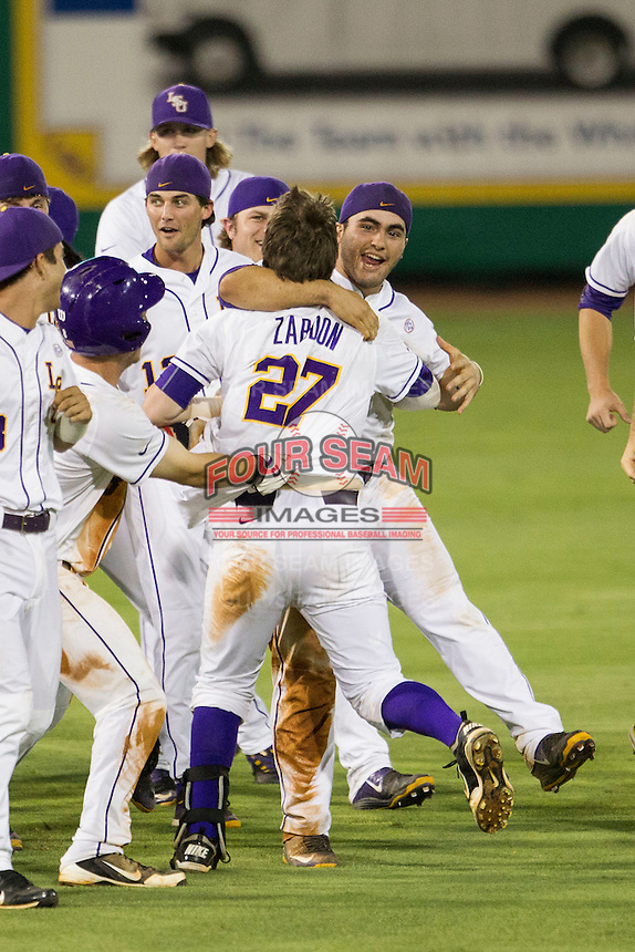 LSU Tigers first baseman Chris Chinea (26) hugs teammate Danny Zardon (27) following his walkoff hit in the Southeastern Conference baseball game against the Texas A&M Aggies on April 23, 2015 at Alex Box Stadium in Baton Rouge, Louisiana. LSU defeated Texas A&M 4-3. (Andrew Woolley/Four Seam Images)