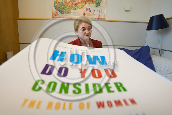 BRUSSELS - BELGIUM - 27 MAY 2008 -- MEP Anna ZABORSKA (ZÁBORSKÁ) seen behind a poster with the text >How do you consider the role of women in parlamentary work?.  Photo: Erik Luntang/EUP-IMAGES