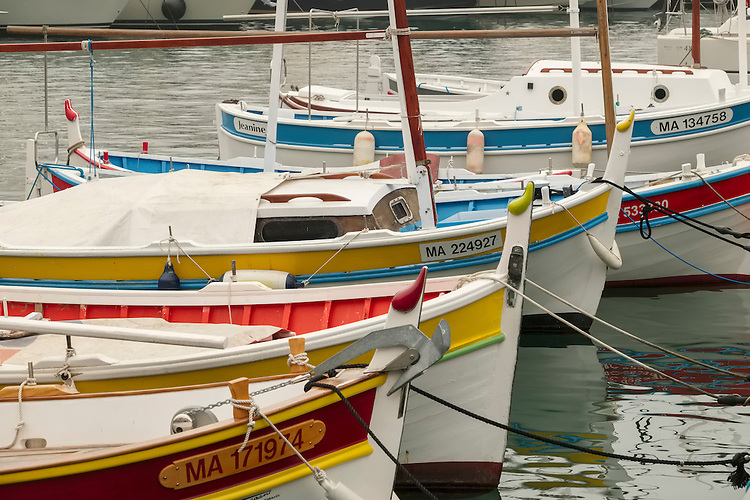 Rows of colorful fishing boats provide the scenic focal point in the harbor of Cassis.