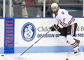 Justin Daniels (Northeastern - 11) - The visiting Merrimack College Warriors defeated the Northeastern University Huskies 4-3 (OT) on Friday, February 4, 2011, at Matthews Arena in Boston, Massachusetts.