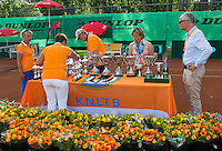 August 9, 2014, Netherlands, Rotterdam, TV Victoria, Tennis, National Junior Championships, NJK,  Preparing the trophy table, l.t.r.: Gila Langen, Wilma Oosters-Meijer, Hans Langen Tournament director Petra Hermans-Verloop and Chris van Gennip<br /> Photo: Tennisimages/Henk Koster