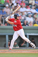 Catcher Tyler Spoon (15) of the Greenville Drive bats in a game against the Augusta GreenJackets on Friday, June 10, 2016, at Fluor Field at the West End in Greenville, South Carolina. Greenville won, 5-4. (Tom Priddy/Four Seam Images)