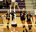 SIOUX FALLS, SD - SEPTEMBER 19:  Jordan Calef #3 from the University of Sioux Falls tries to tip the ball past Dani Magdzas #11 from Augustana during their match Saturday afternoon at the Stewart Center. (Photo by Dave Eggen/Inertia)