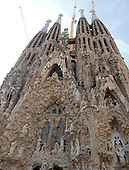 The Nativity façade of the Basilica de la Sagrada Família (Basilica and Expiatory Church of the Holy Family) in Barcelona, Spain on October 19, 2013.  It is dedicated to the birth if Jesus and is ornately decorated with scenes from the Nativity.  This view includes much of the sculpture and the towers.<br /> Credit: Ron Sachs / CNP