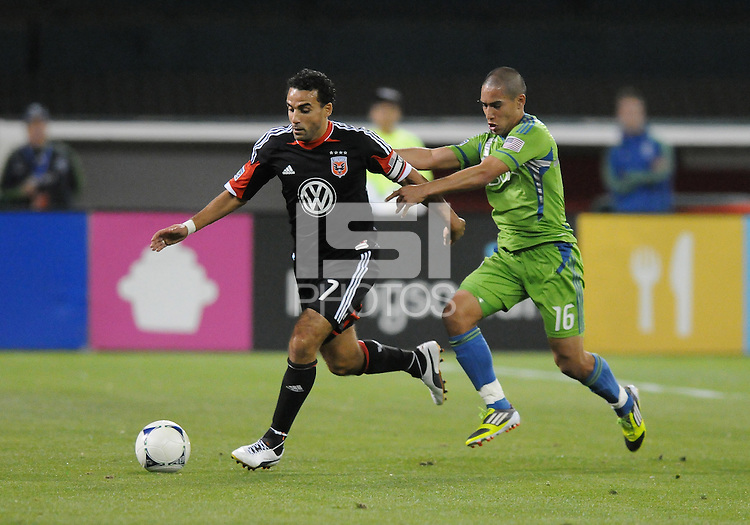 D.C. United forward Dwayne De Rosario (7) shields the ball against Seattle Sounder forward David Estrada (16)  D.C. United tied The Seattle Sounders 0-0 at RFK Stadium, Saturday April 7 , 2012.
