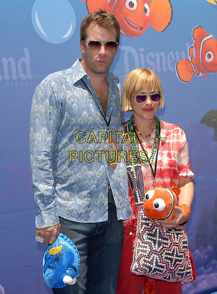 THOMAS JANE, PATRICIA ARQUETTE .attends The Finding Nemo Submarine Voyage Celebrity Preview held in Tomorrowland at Disneyland in Anaheim, California, USA, June 10 2007                                                                     half length sunglasses married husband wife red jeans  plaid tartan shirt.CAP/DVS.©Debbie VanStory/Capital Pictures