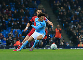 9th January 2018, Etihad Stadium, Manchester, England; Carabao Cup football, semi-final, 1st leg, Manchester City versus Bristol City; Leroy Sane of Manchester City is challenged by Bailey Wright of Bristol City