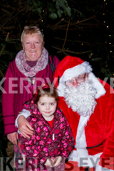 Ava Grace and Breda O'Shea met Santa Claus at the  turning on the Christmas lights in Killorglin on Saturday evening