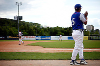 25 June 2011: Guillaume Coste of Team France. Illustration of a photographic essay called Life in the dugout, during Czech Republic 11-1 win over France, at the 2011 Prague Baseball Week, in Prague, Czech Republic.