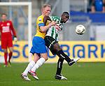Nederland, Waalwijk, 21 oktober 2012.Eredivisie.Seizoen 2012-2013.RKC-PEC Zwolle.Fred Benson (r.) van PEC Zwolle en Henrico Drost (l.) van RKC strijden om de bal.