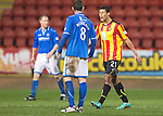 Partick Thistle v St Johnstone....21.01.14   SPFL<br /> Lyle Taylor goes nuts at Lee Mair who gave the ball back to saints after a drop ball<br /> Picture by Graeme Hart.<br /> Copyright Perthshire Picture Agency<br /> Tel: 01738 623350  Mobile: 07990 594431