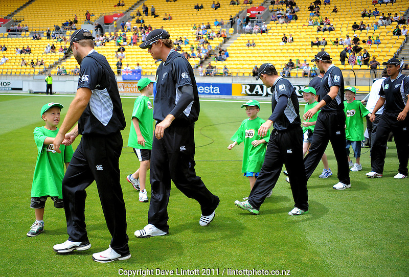 The Black Caps walk out with Milo kids before the match. First one-day international cricket match - New Zealand v Pakistan at Westpac Stadium, Wellington, New Zealand on Saturday, 22 January 2011. Photo: Dave Lintott / lintottphoto.co.nz