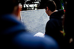 Students check a bulletin board at the Occupy UC Davis encampment, November 28, 2011.