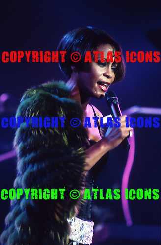 Whitney Houston (Aug 9, 1963 - Feb 11, 2012) performing live on the My Love Is Your Love UK Tour at Wembley Arena in London UK - 16 Sep 1999.  Photo credit: George Chin/IconicPix/AtlasIcons.com