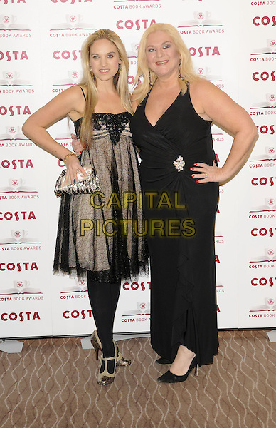 ALLEGRA KURER & VANESSA FELTZ .2009 Costa Book Awards, Intercontinental Hotel, London, England, January 27th 2009..full length mother daughter family black dress long maxi hands on hips cleavage sheer tights layered t-bar shoes .CAP/DH.©David Hitchens/Capital Pictures