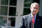 Washington, D.C. - October 3, 2008 -- United States President George W. Bush pauses while speaking in the Rose Garden of the White House, Friday, October 3, 2008 in Washington, DC.  The US House of Representatives voted earlier in the day to approve a revised version of Wall Street bail out legislation.   <br /> Credit: Brendan Smialowski - Pool via CNP