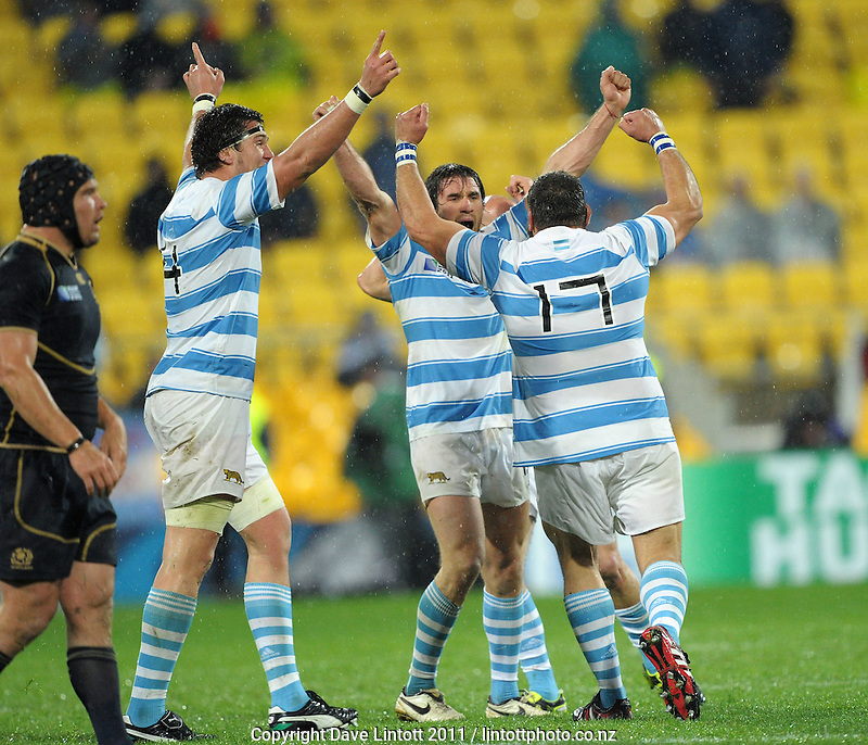 Argentina players celebrate victory during the Argentina v Scotland pool B match of the 2011 IRB Rugby World Cup at Wellington Regional Stadium, Wellington, New Zealand on Sunday, 25 September 2011. Photo: Dave Lintott / lintottphoto.co.nz
